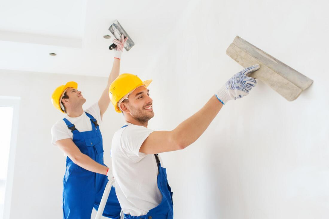 professional drywall contractors working on drywall repair